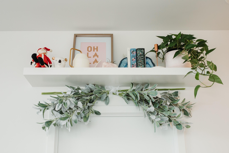 Condo Christmas Decor Ideas: attach eucalyptus garlands with clear 3M hooks to create a unique DIY garland!