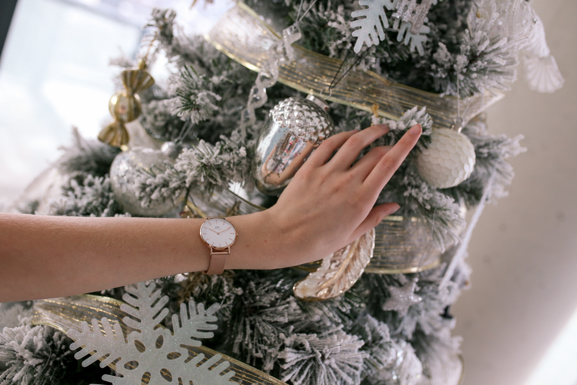 The Daniel Wellington Petite Melrose watch is a modern classic. With Milanese mesh and a white bold face, it's super chic and versatile. Enter to win your own Daniel Wellington watch in this post!