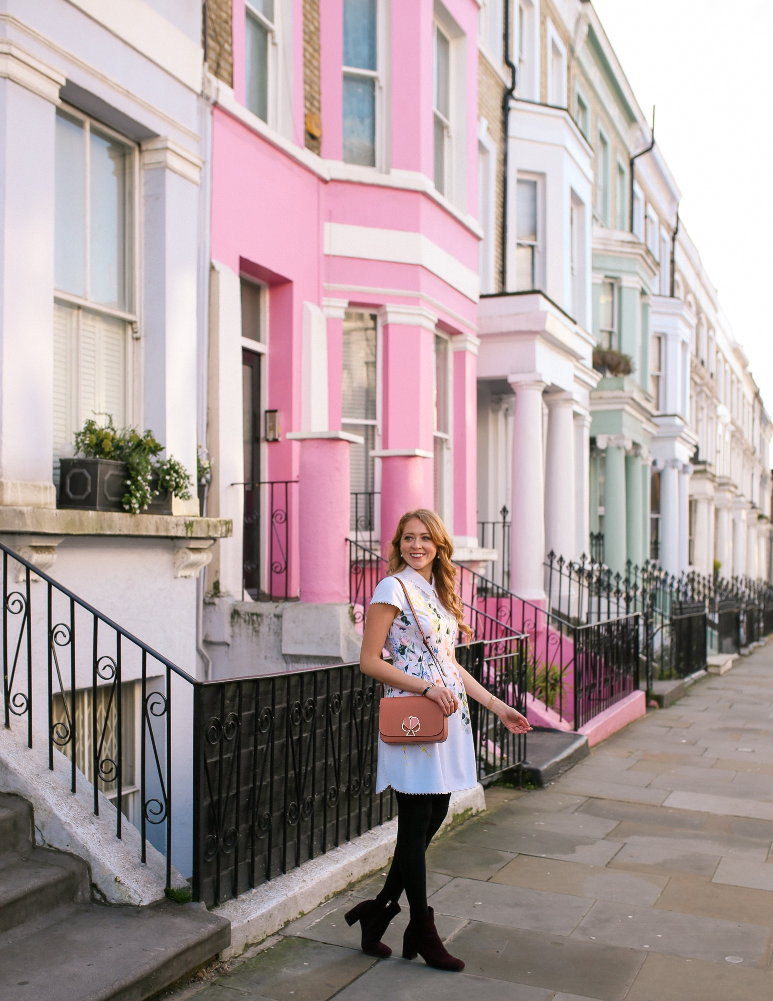 Notting Hill is full of colourful houses that are perfect for photos. I wore a Ted Baker dress and Kate Spade Nikola bag to fit in with my feminine surroundings.