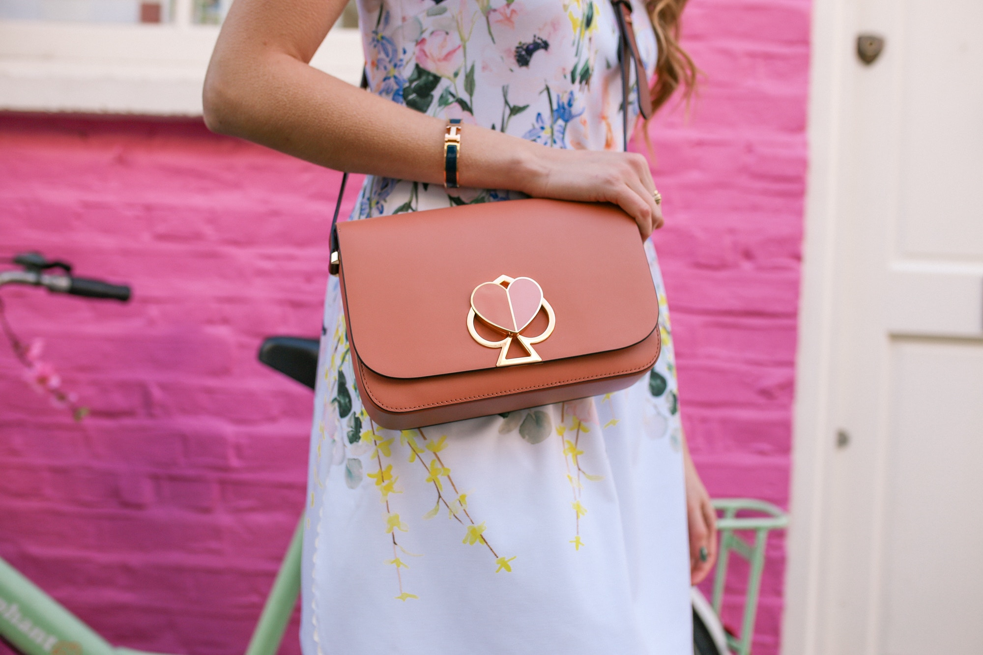The Kate Spade Nikola bag is the perfect cute bag featuring a heart-shaped clasp.