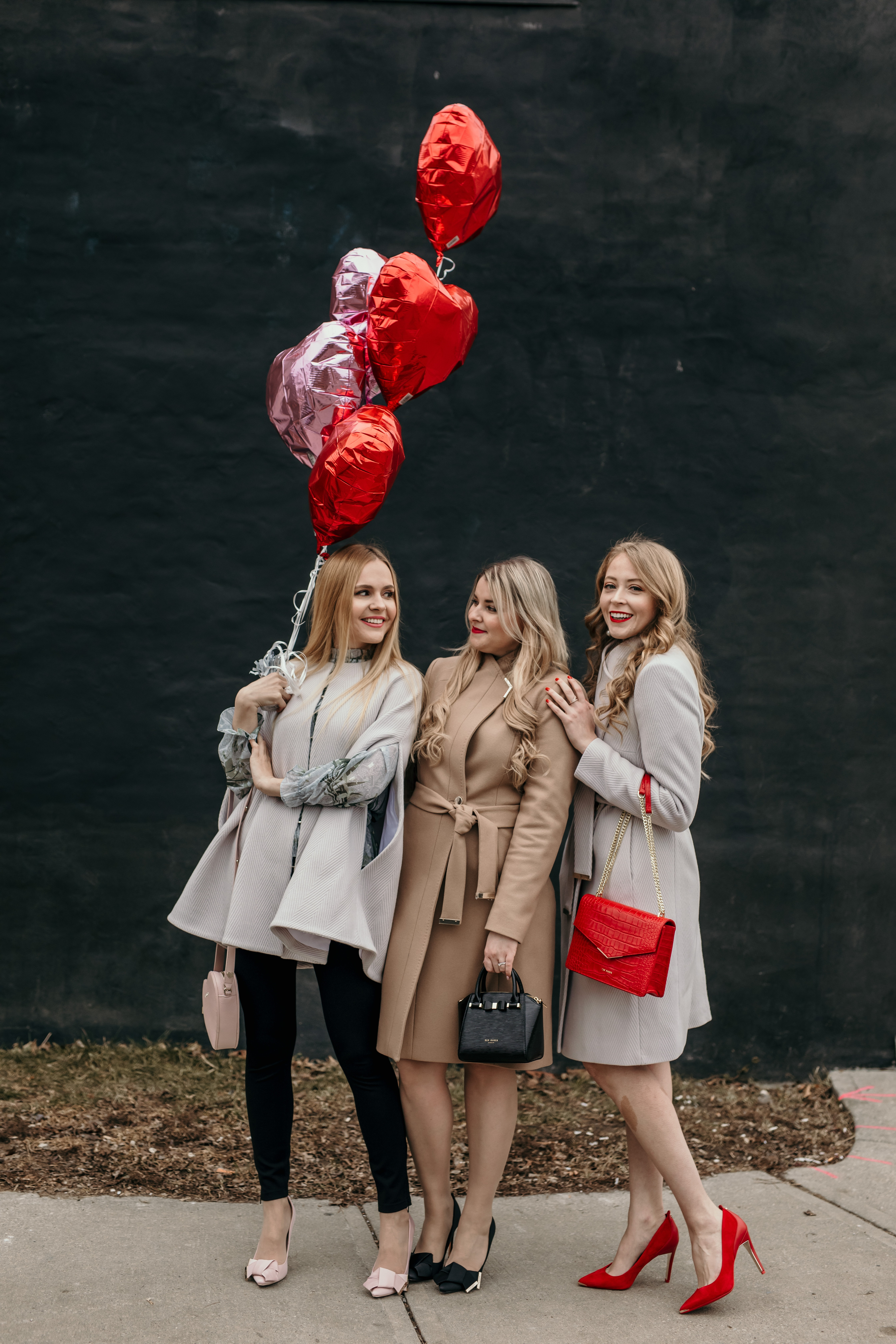 Ted Baker Galentine's Day Looks: wool coats and capes, heart handbags, pops of red and elegant dresses.