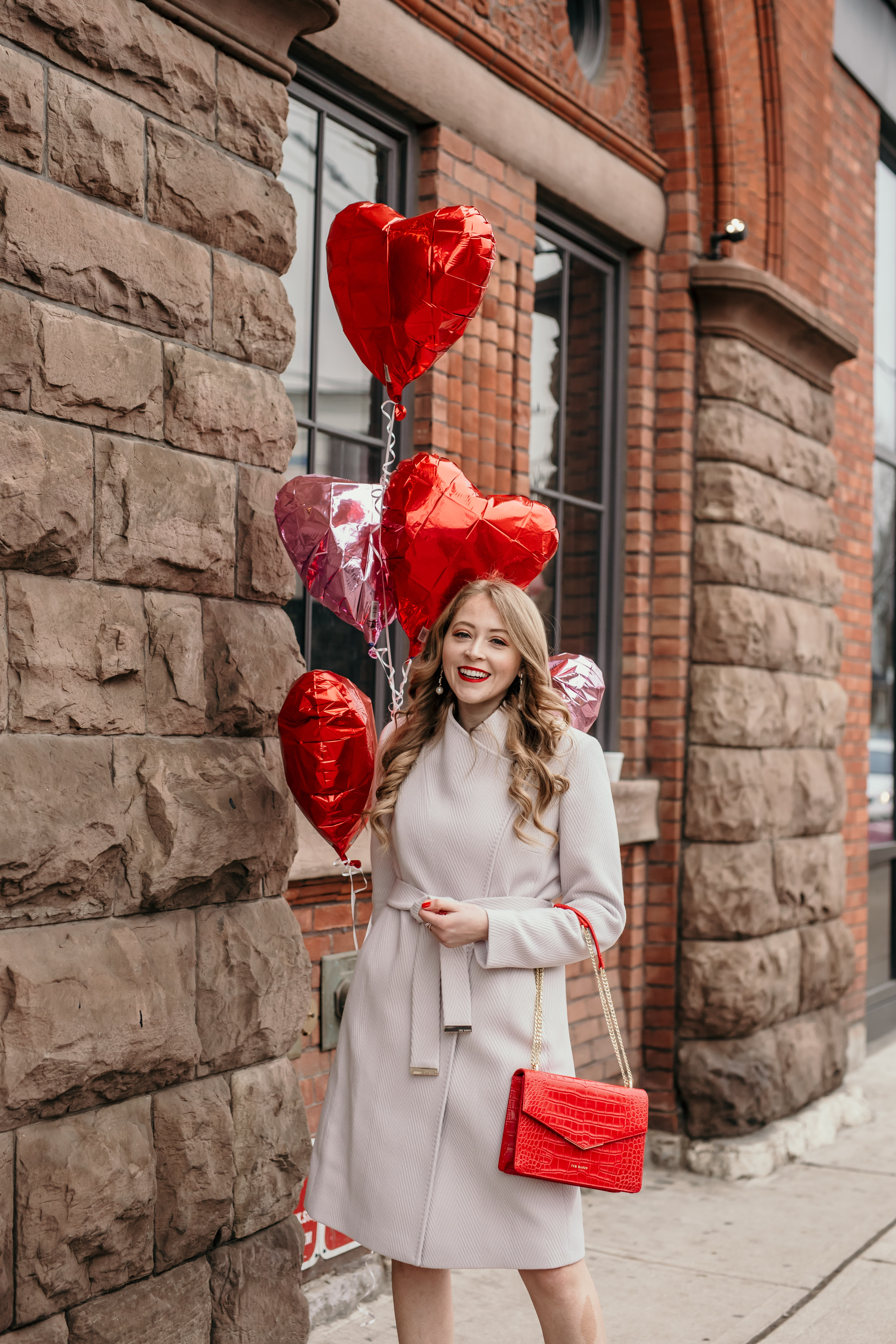 Ted Baker Beleeni Wool Wrap Coat: this chic light mauve coat is so elegant and feminine. Paired with a red croc embossed envelope bag from Ted Baker, this look is perfect for Valentine's Day!