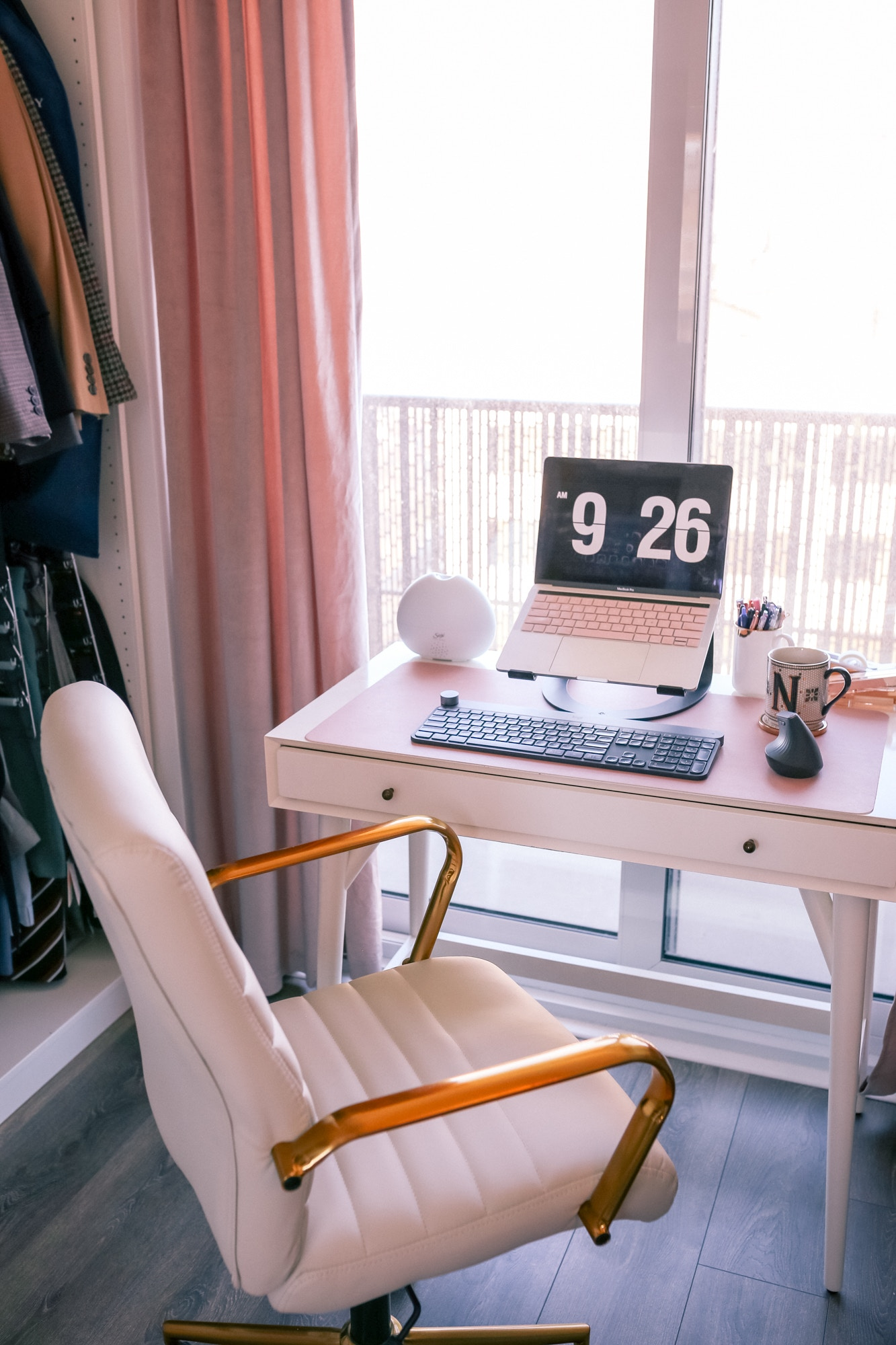 If you're working from home during self-isolation make sure to have a clean desk setup with a comfortable desk chair, sturdy desk and a laptop stand to be ergonomic.