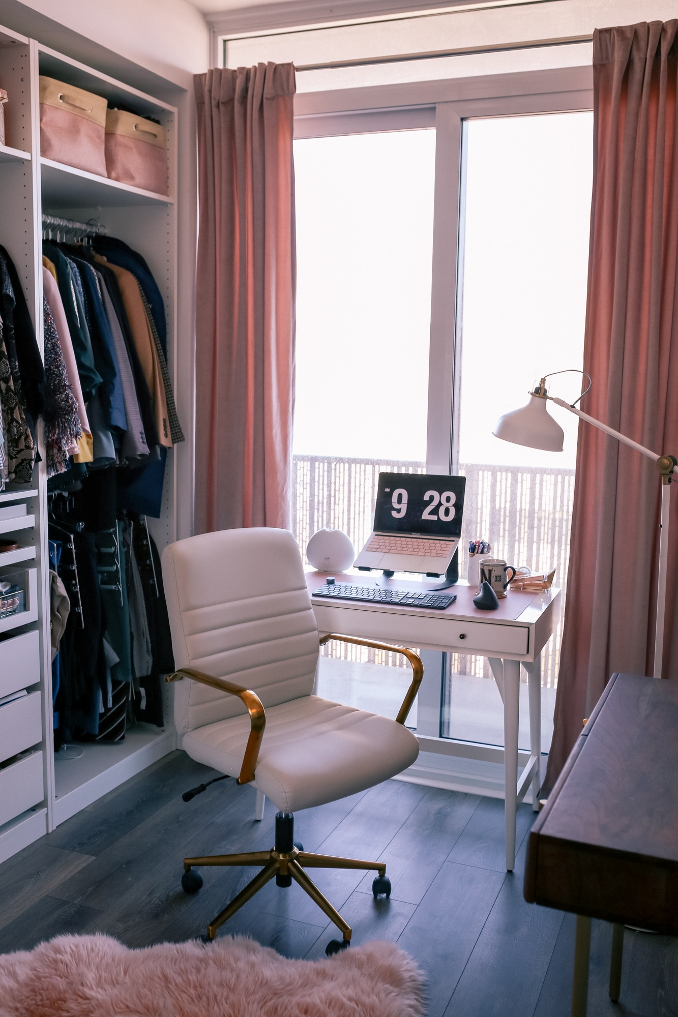 Home Office Decor Tips: Creating a serene space for productivity during self-isolation. West Elm Mid-Century Desk, IKEA Pax wardrobe & a gold desk chair complete the look.