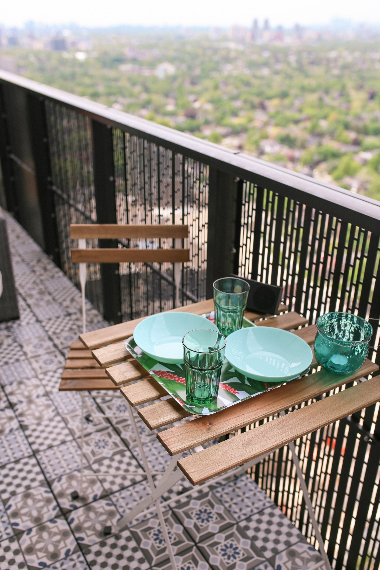 The IKEA Tärnö Bistro Set is a classic cheap and chic option for small spaces. I love that it folds up and makes for the perfect dining area on my balcony.