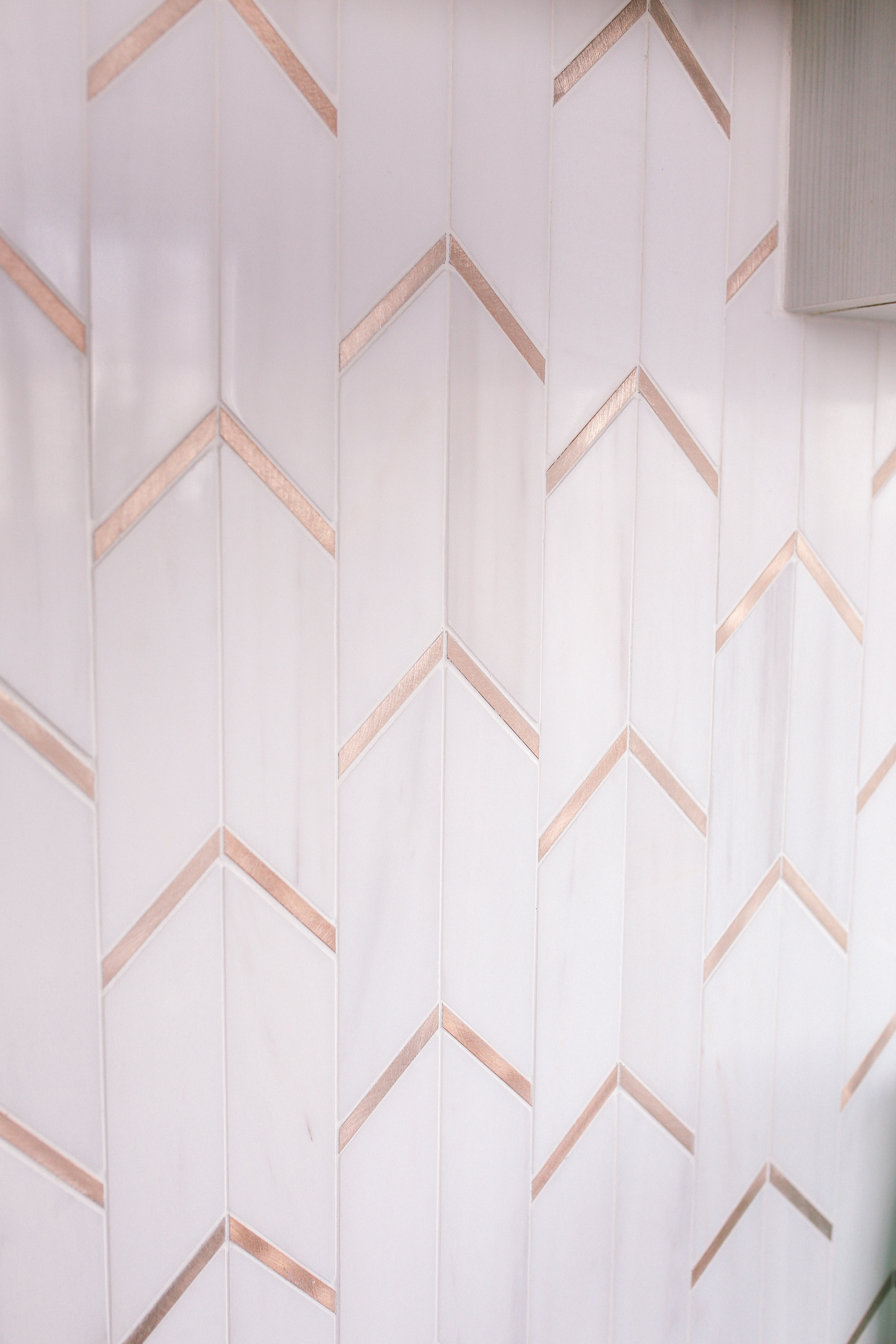 Chevron marble with gold metal inlay