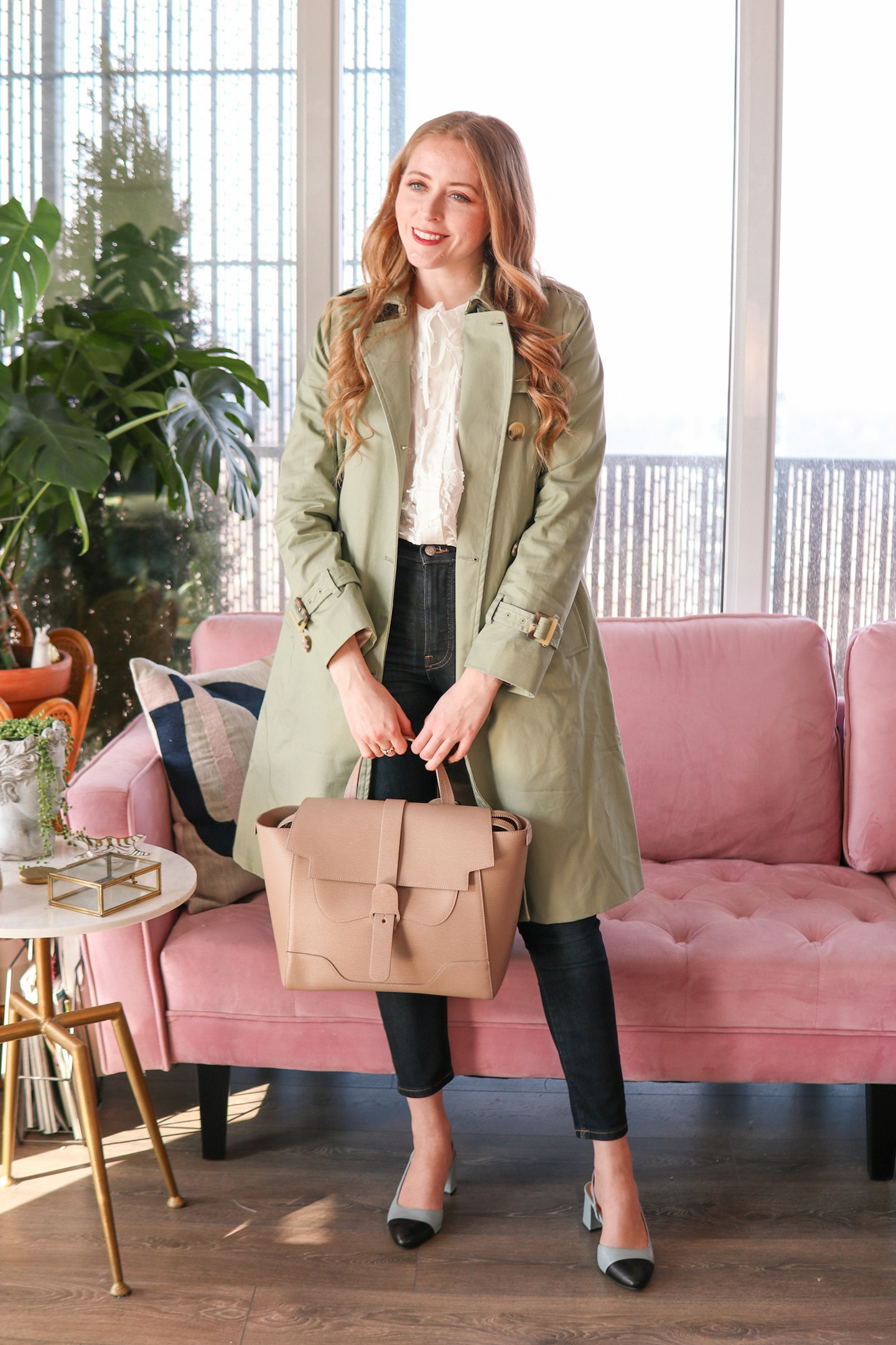 This green trench coat is SO chic. I love how it pairs effortlessly with a white cotton blouse and jeans, or layered over a dress for a feminine dressy look. This trenchcoat for under $150 was such a steal, and also has weatherproof fabric! I paired it with the white cotton baby-collar blouse, my Senreve Maestra bag (get $50 off with code NATALIEAST) and a pair of cap-toe mules from L'Intervalle.